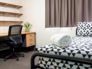 bed and student study desk